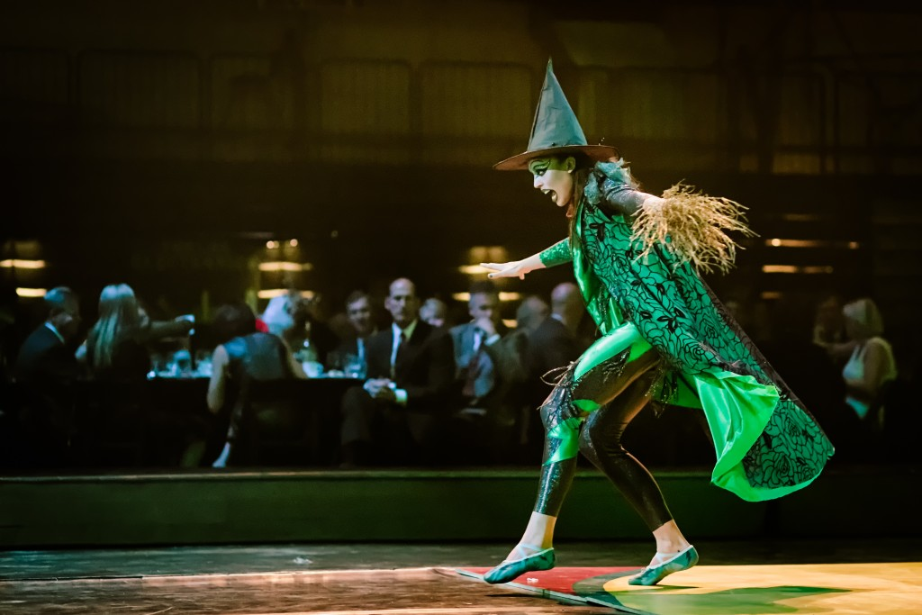 A witch dashes across the mat at the 2013 gala. Photo by Bill Raab.