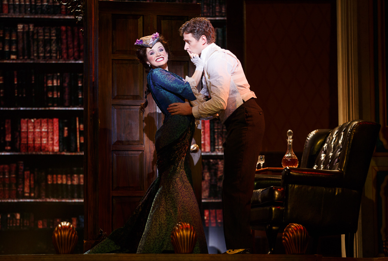 Phoebe D'Ysquith (Adrienne Eller) delivers some welcome news to Monty Navarro (Kevin Massey). Photo by Joan Marcus.