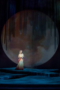 "Kelly Kaduce sings the famous ""Song to the Moon"" to a Supermoon backdrop. Photo by Dan Norman."