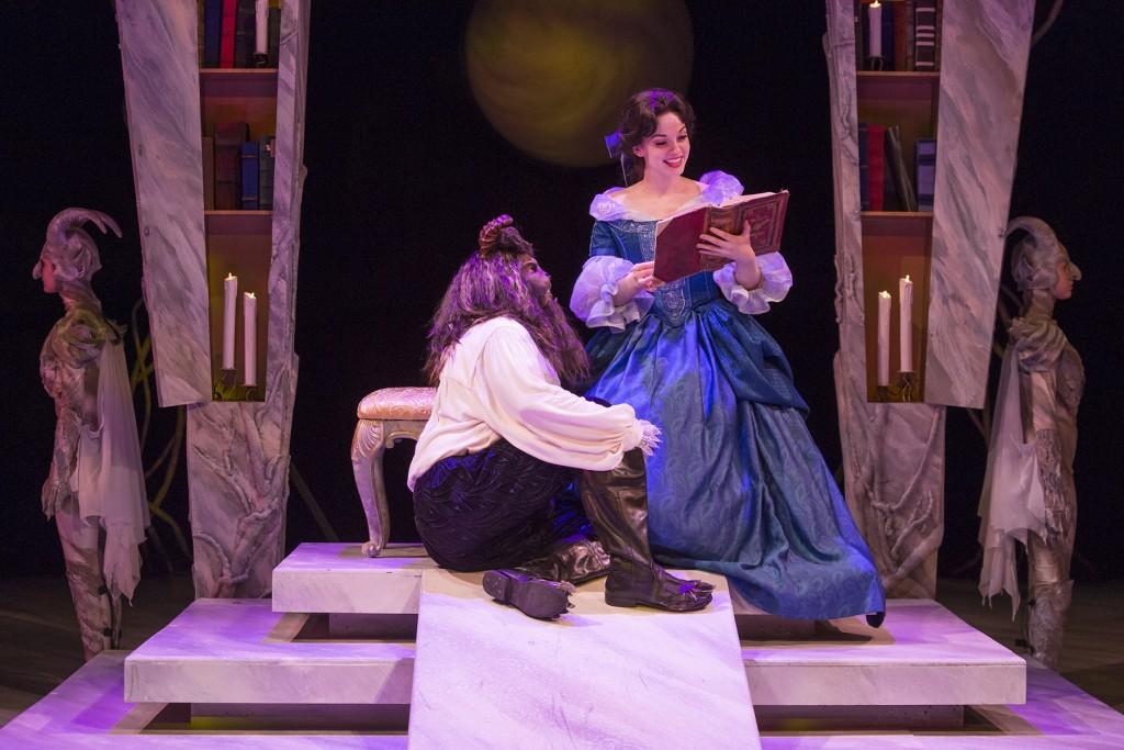 The Beast (Robert O. Berdhal) listens to Belle (Ruthanne Heyward) read.
