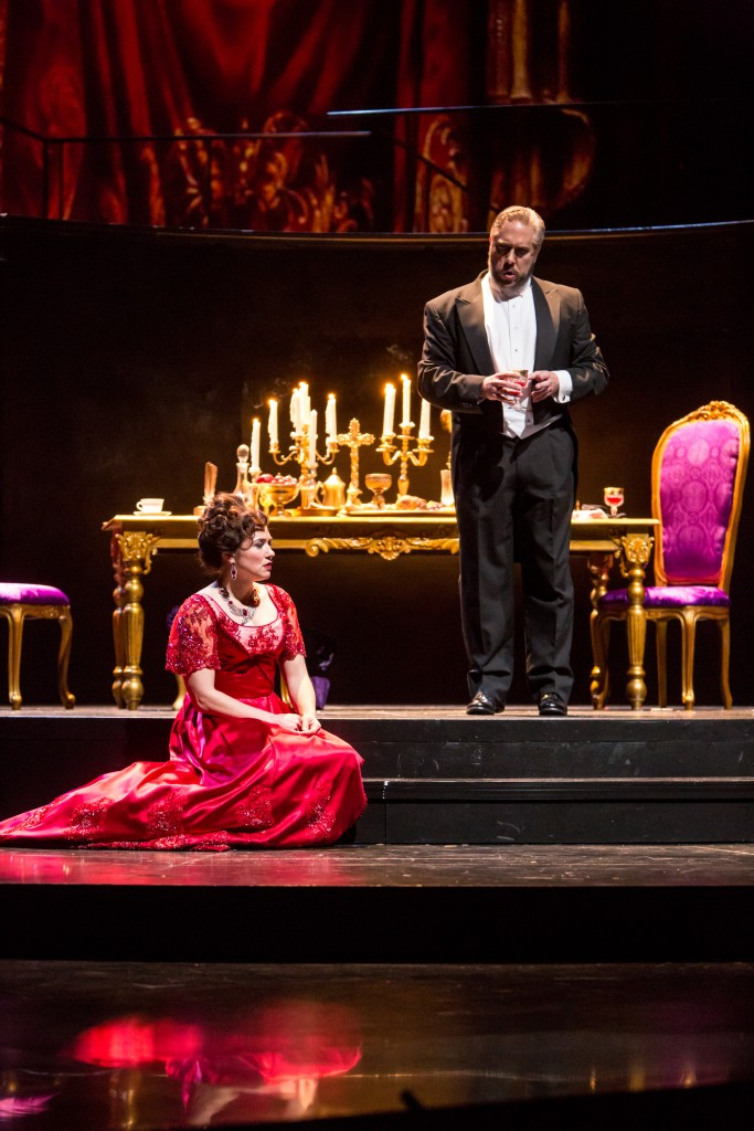 Scarpia (Stephen Powell) gives Tosca (Kelly Kaduce) an indecent proposal.