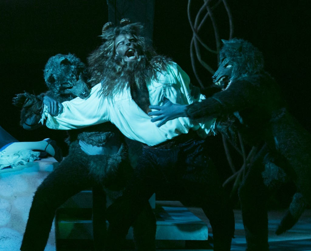 The Beast (Robert O. Berdhal) fights off a pack of wolves.