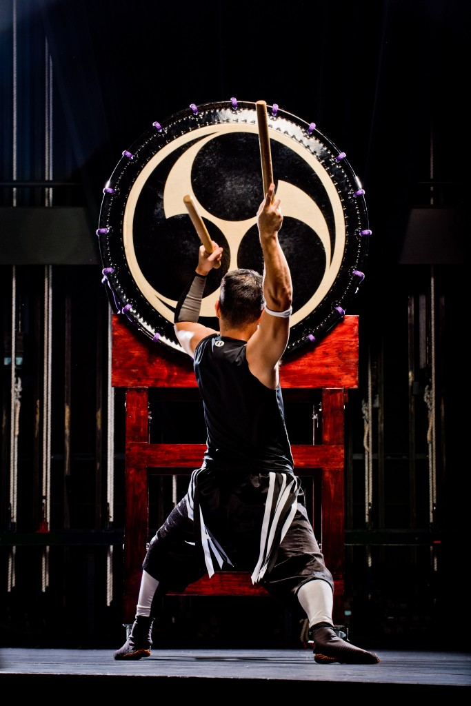 A member of TAIKOPROJECT poses at the drum.