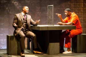 L-R: Brothers Eric (Darius Dotch) and Bilal (Ansa Ankyea) argue about musical matters. Photo by Dan Norman.