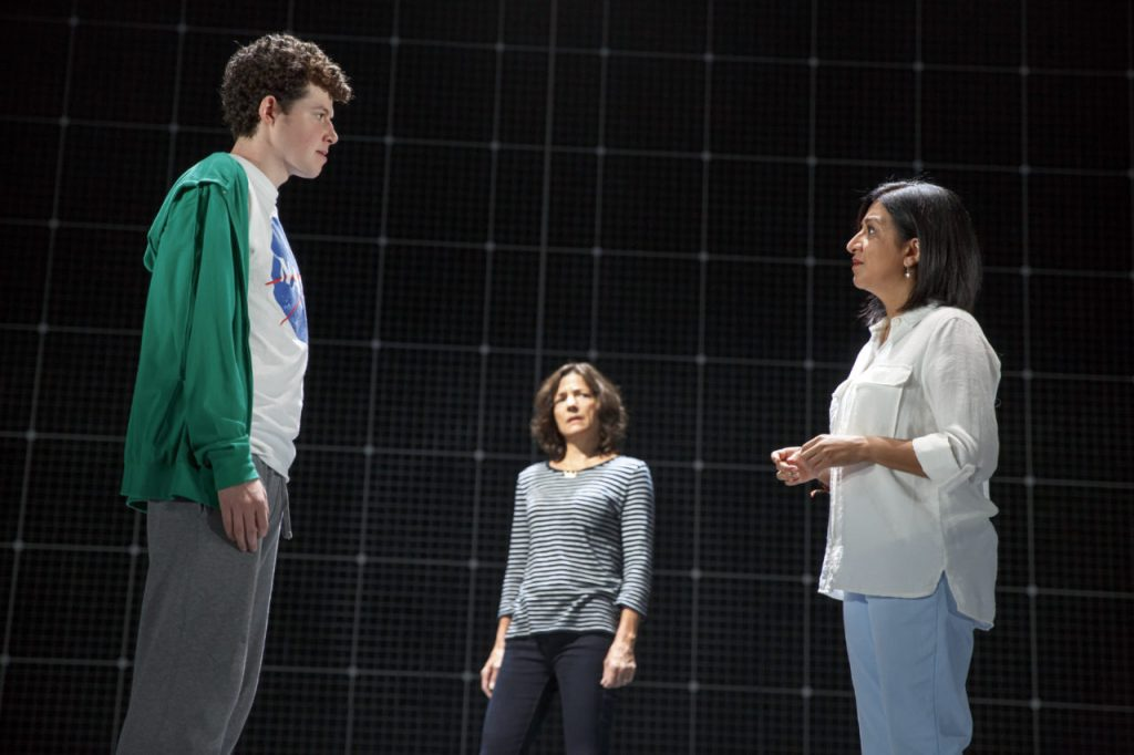 Adam Langdon as Christopher Boone, Felicity Jones Latta as Judy and Maria Elena Ramirez as Siobhan in the touring production of The Curious Incident of the Dog in the Night-Time. Photo by Joan Marcus.